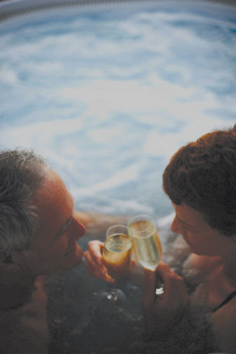 Couple Toasting in an Atera Spa