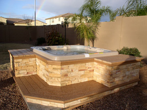 Trex Decking and stacked stone on custom spa surround